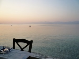 Photo of table and chair near sea.